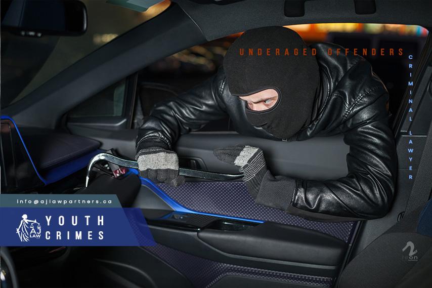 Criminal-lawyer-Youth-Crimes-carjacker-unlock-glove-box-with-crowbar-male-thief-with-balaclava-his-head-hack-car-carjacking-danger-aj-law-llp